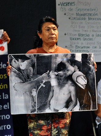 One of the advocates for Braceros' rights display a photo of a Bracero being sprayed with the deadly chemical DDT. Photo by NOEL T. PANGILINAN