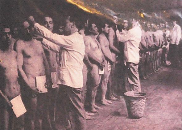 An old photo of Braceros undergoing physical examination.  Photo courtesy of Coordinadora Binacional de Ex Braceros (COBIEB)
