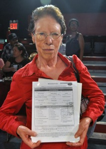 Maria Elyda Samarrones Escarcega showing the documents of her father, a former Bracero.  Photo by NOEL T. PANGILINAN