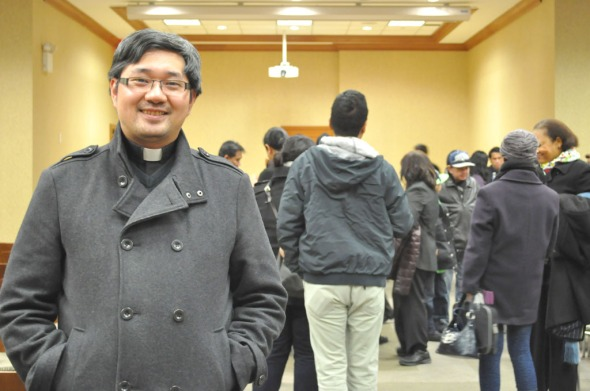 Fr. Patrick Longalong at the public forum on Feb. 1 at the Church of St. Francis of Assisi in Manhattan. Photo by Noel T. Pangilinan